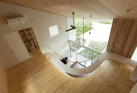 a gentle blanket like roof covers the daylit interiors of this