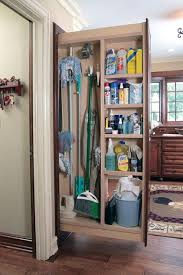 12 inch broom cabinet everyone needs a broom closet here the brooms mops and cleaning