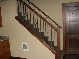 wrought iron panels with alder stained posts portland stair