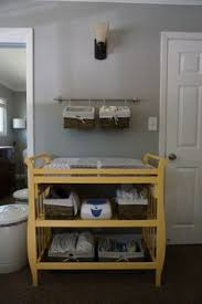 chagne baskets hang baskets above changing table with surface space