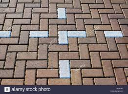 abstract herringbone block paving in a car park pattern stock