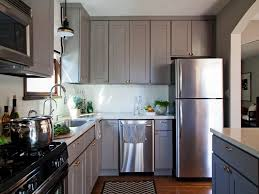 grey kitchen cabinets with white countertops chromed stainless