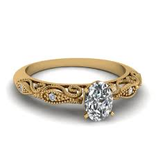 yellow gold diamond rings oval shaped diamond engagement ring in 18k yellow gold