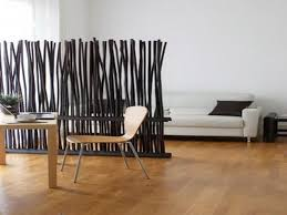 wall divider with branches coming up to divide the space partially
