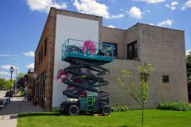 installation underway for bay view street canvas mural project headed by a team of experienced professional artists the agency connects business owners and community groups to the international community of artists