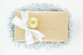 silver boxes with bows on top wrapped vintage gift box with white ribbon bow silver tinsel