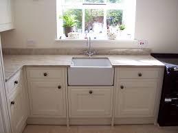 granite countertop white thermofoil cabinets smeg black