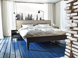 we love the warm and natural look of the nornäs queen bed frame