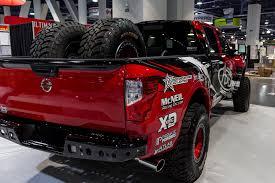 nissan truck titan red sema show 2016 addictive desert designs
