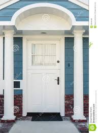 White Front Door White Front Door Of Classical Blue And Brick Home Stock Photo