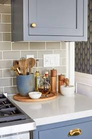 emily henderson blue grey kitchen with concrete tiles in bold