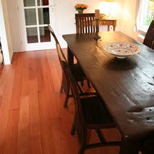 tiete rosewood flooring has turned this otherwise drab kitchen