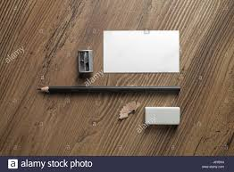bank business card pencil eraser and sharpener on wood table