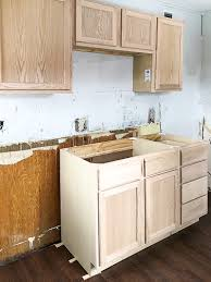 how to paint unfinished cabinets unfinished wood cabinets to make the flip house kitchen