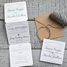 heart tri fold wedding invitation on white by paper and inc