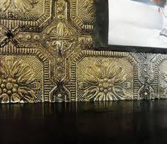 Wall Paper Backsplash - faux tin backsplash using textured wallpaper painted with metallic