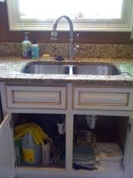 under kitchen sink storage solutions how to declutter under your kitchen sink cabinet