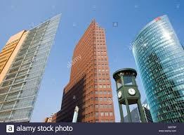 clock tower and modern buildings potsdamer platz berlin germany