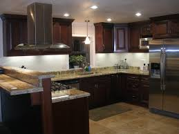 kitchen grey granite countertops with black island galley kitchen remodel ideas beige tile ceramic flooring yellow granite countertops stainless steel open door