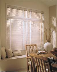 decorating window decor with white levolor blinds on wheat wall