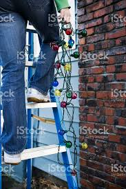 hanging christmas lights on brick walls christmas lights hanging from ladder outside chimney copy space