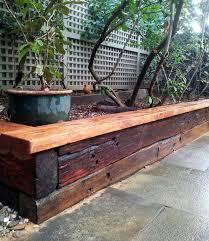 stained railway sleeper garden bed gardening for beginners