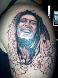 smoking bob marley tattoo on left shoulder