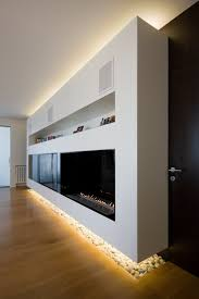 i like the way they u0027ve lit below the fireplace build out must