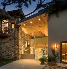 stone and glass wall hall modern with frameless glazing
