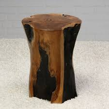 narrow tree trunk coffee table on soft fluffy area rug decofurnish