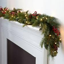 lighted christmas tree garland christmas greenery pre lit decorated or basic brookstone