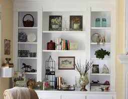 high white wooden shelves with many shelves for books and