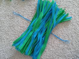 make pom poms to cheer on your kids you can make them any color