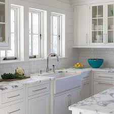 white kitchen with calcutta gold marble mini subway tiles