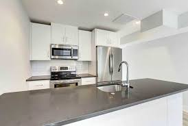 white cabinets with black countertops and backsplash white kitchen cabinets with countertops designing idea