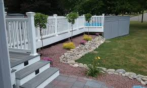 new composite deck with landscaping and pavers in corning