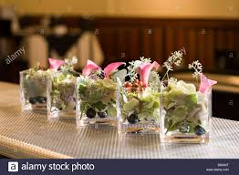 Small Glass Vase Small Glass Vases Holding A Beautiful Floral Arrangement Stock