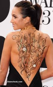 images of the back of laura wright hair wright shows off sexy body art in backless dress
