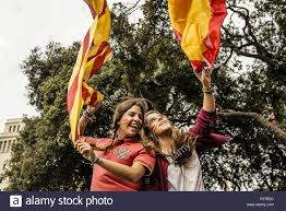 Flags In Spanish Barcelona Catalonia Spain 12th Oct 2015 Two Girls Have Fun