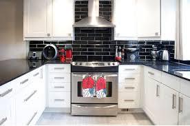 white kitchen cabinets with black subway tile backsplash kitchen subway tiles are back in style 50 inspiring designs