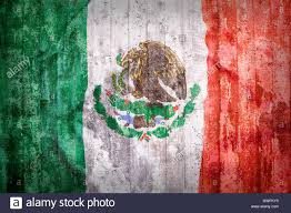 grunge style of mexico flag on a brick wall for background stock
