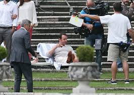 nespresso commercial actress jack black george clooney wears flip flops with suit for nespresso ad daily