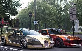 bugatti gold and gold bugatti veyron draws london crowds lux pursuits