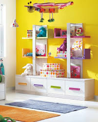 kids room storage units purple stain cupboard space saver wood kids room storage units purple stain cupboard space saver wood bunk bed blue stain wall green stain wooden floating shelf brown fabric carpet floor