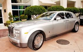 roll royce wraith rick ross rappers and their beautiful cars