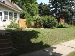 how do i deal with a steep slope in my front yard ask an expert