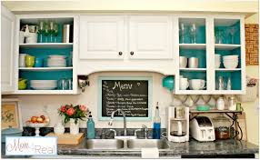 maple wood grey presidential square door open cabinets in kitchen