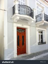 neoclassical home plans beautiful old wooden door neoclassical house stock photo 72548254