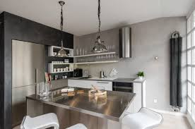 kitchen with concrete wall design and simply white floating shelf