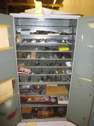 Hardware Storage Cabinet Storage Cabinet W Grinding Wheels Bolts Hardware And Work Bench